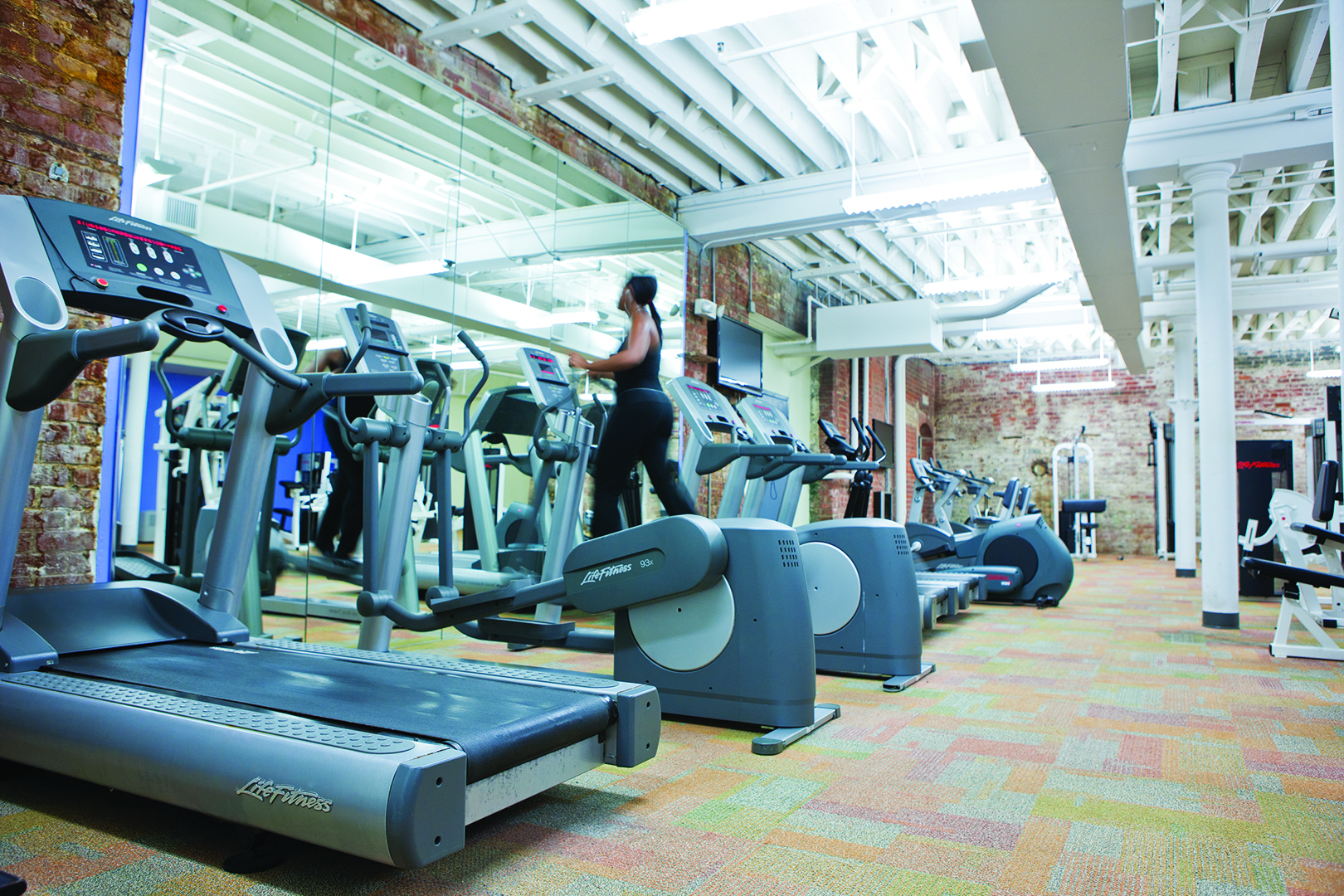 Fitness center at a historic apartment building