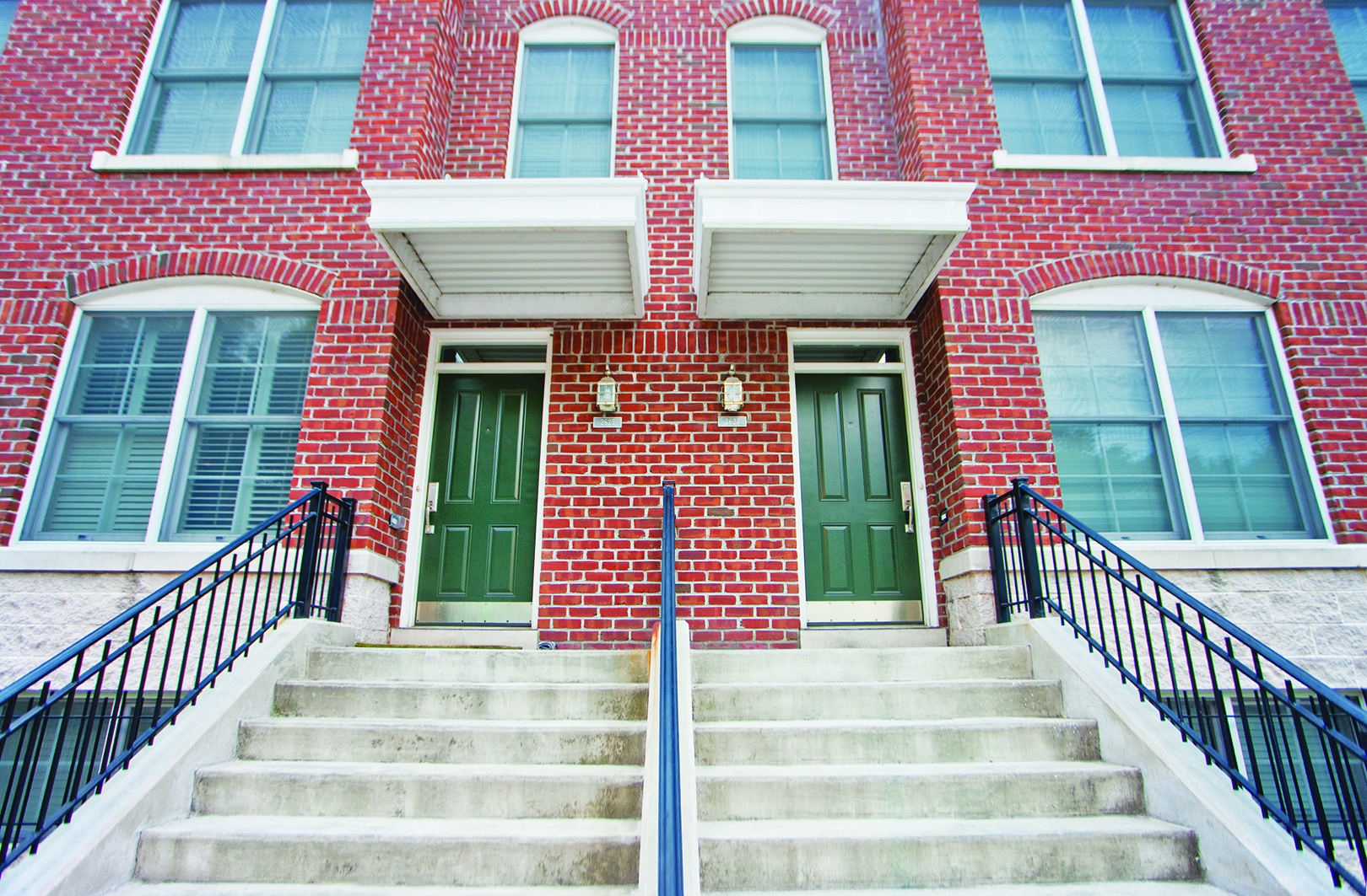 Front doors of apartment townhomes
