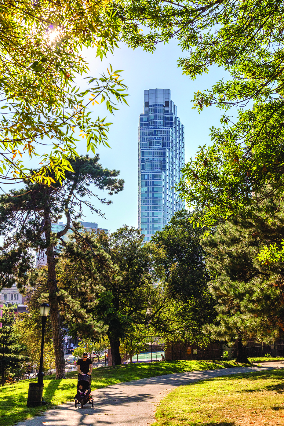 View of a high-rise apartment building from a park