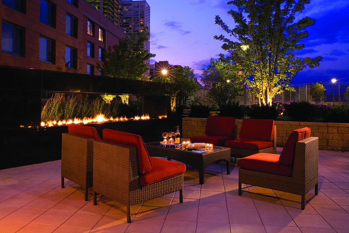 Club Terrace at night of an apartment building