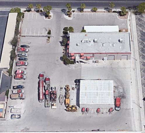 Outdoor Top view of a building where group of cars and trucks are parked in a parking lot