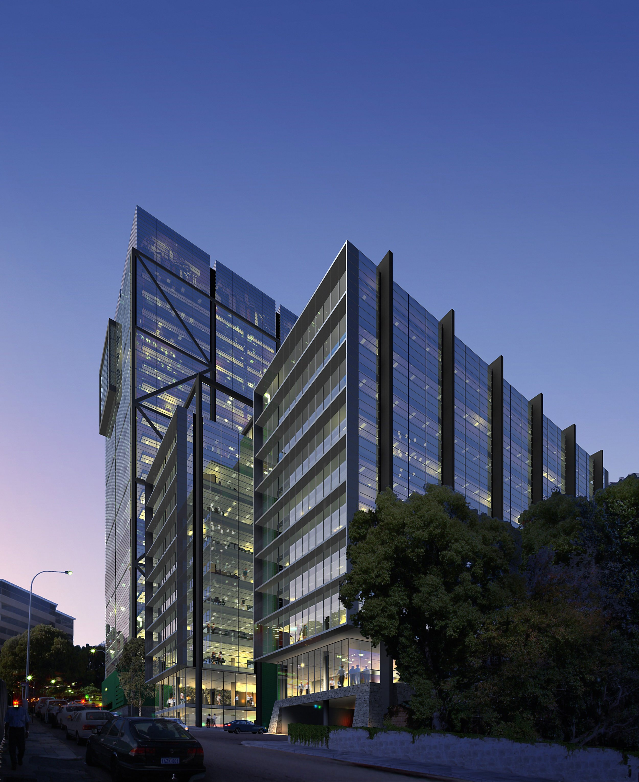 A large glass office building that has many glass panels and some trees that are at the base of it.