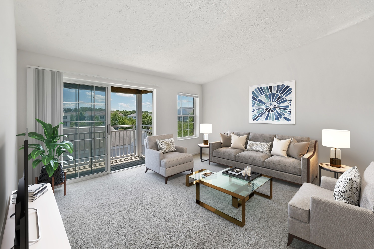 Indoor living room of a apartment building  with a couch and a table and well decorated areas with nice floor carpet