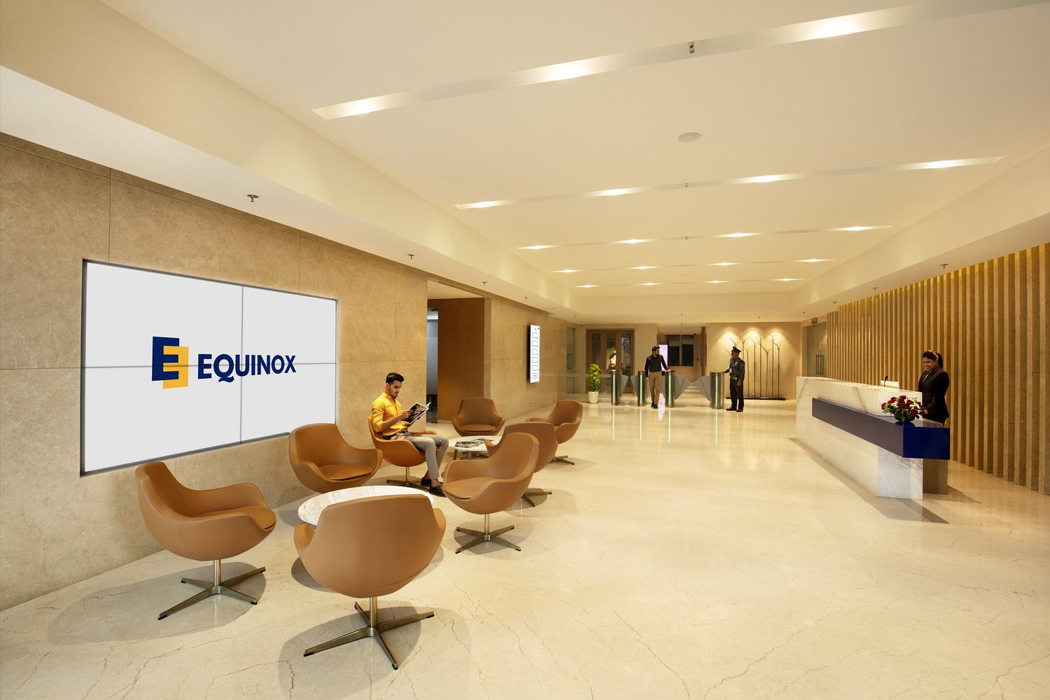 A group of people inside the Equinox lobby that is full of chairs and tables with a tiled floor.