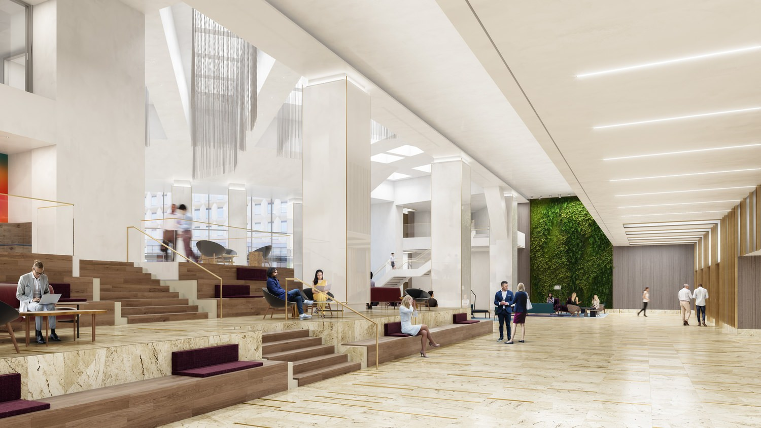 The inside of a large office building that has stairs with seating areas around it and an indoor garden wall.