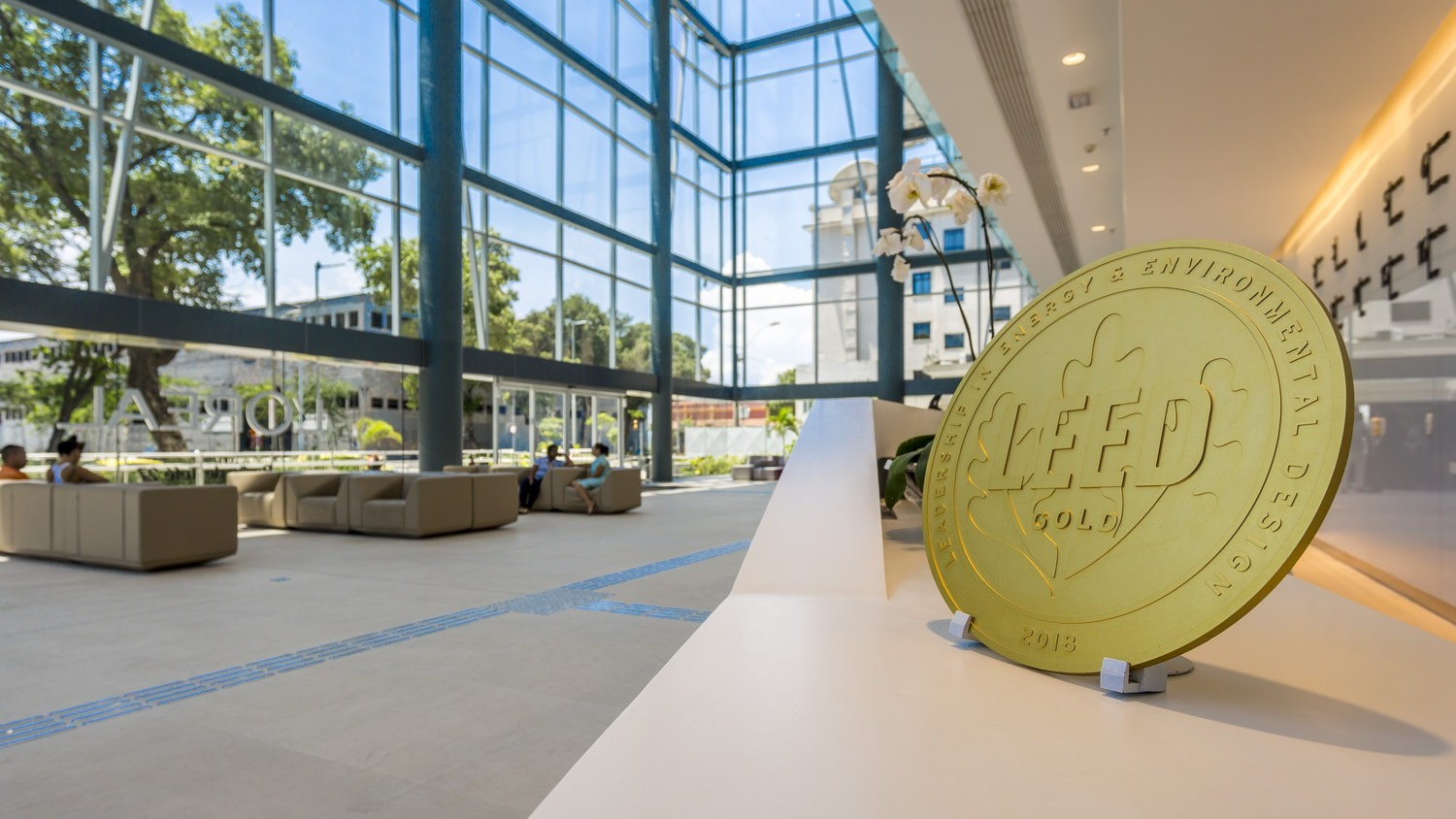 """A photo of an award inside a bright lobby that says """"Leed Gold - Leadership in Energy & Environmental Design 2018"""""""