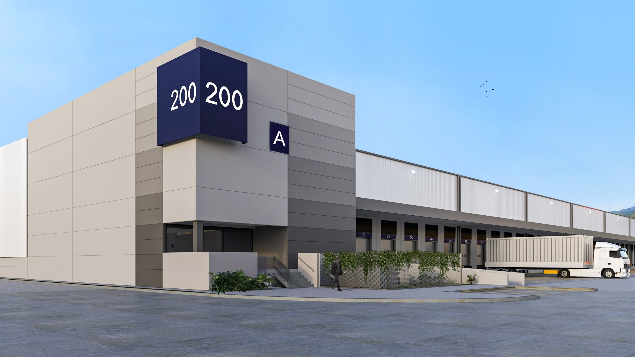 A large warehouse that has an A 200 sign on it and there is a semi truck that is backed into a loadi