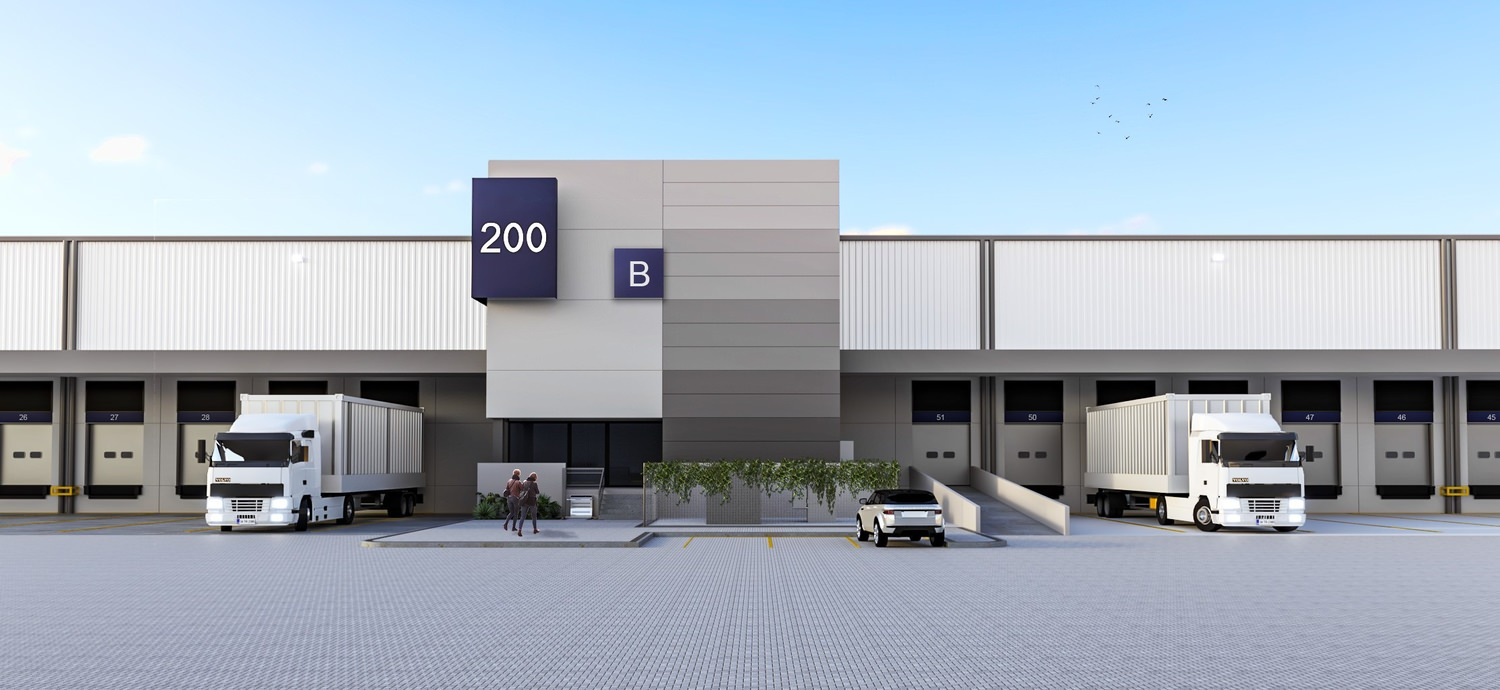 A large building that is labeled as B 200 with semi trucks that are backed into the loading bays of it.