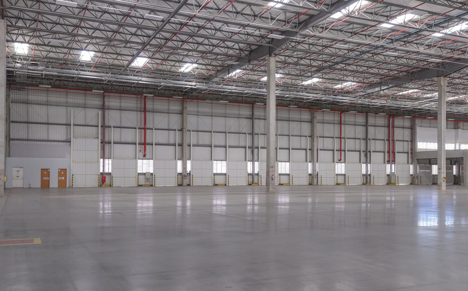 Interior of a large parking area, capable of holding several trucks.