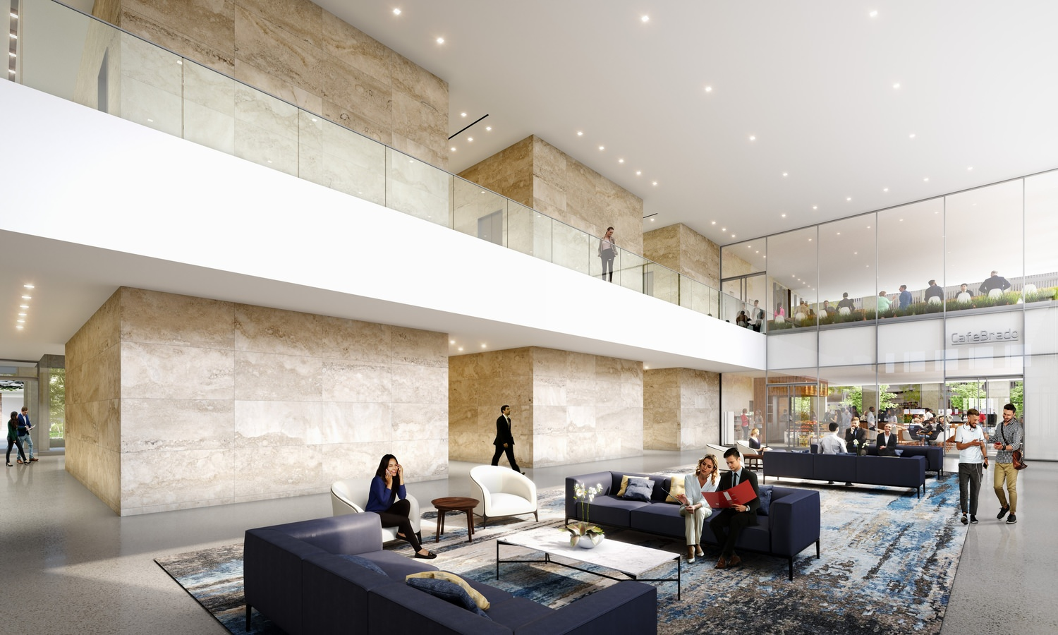 A group of people that are sitting on couches in the lobby of a building that has walkways above it.