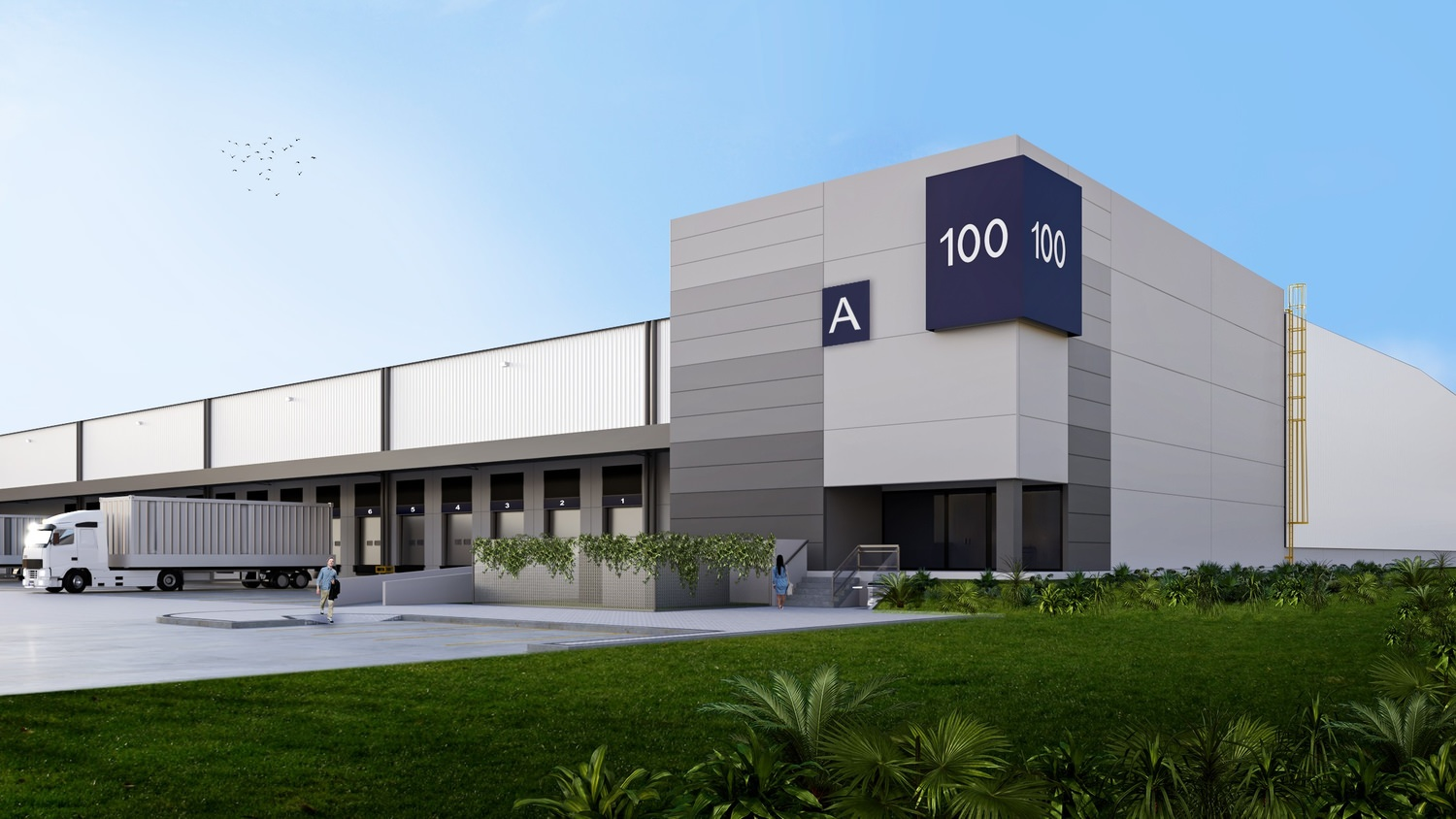 A large warehouse that has a 100 sign on the side of it and a semi truck that is backed up to the loading dock.