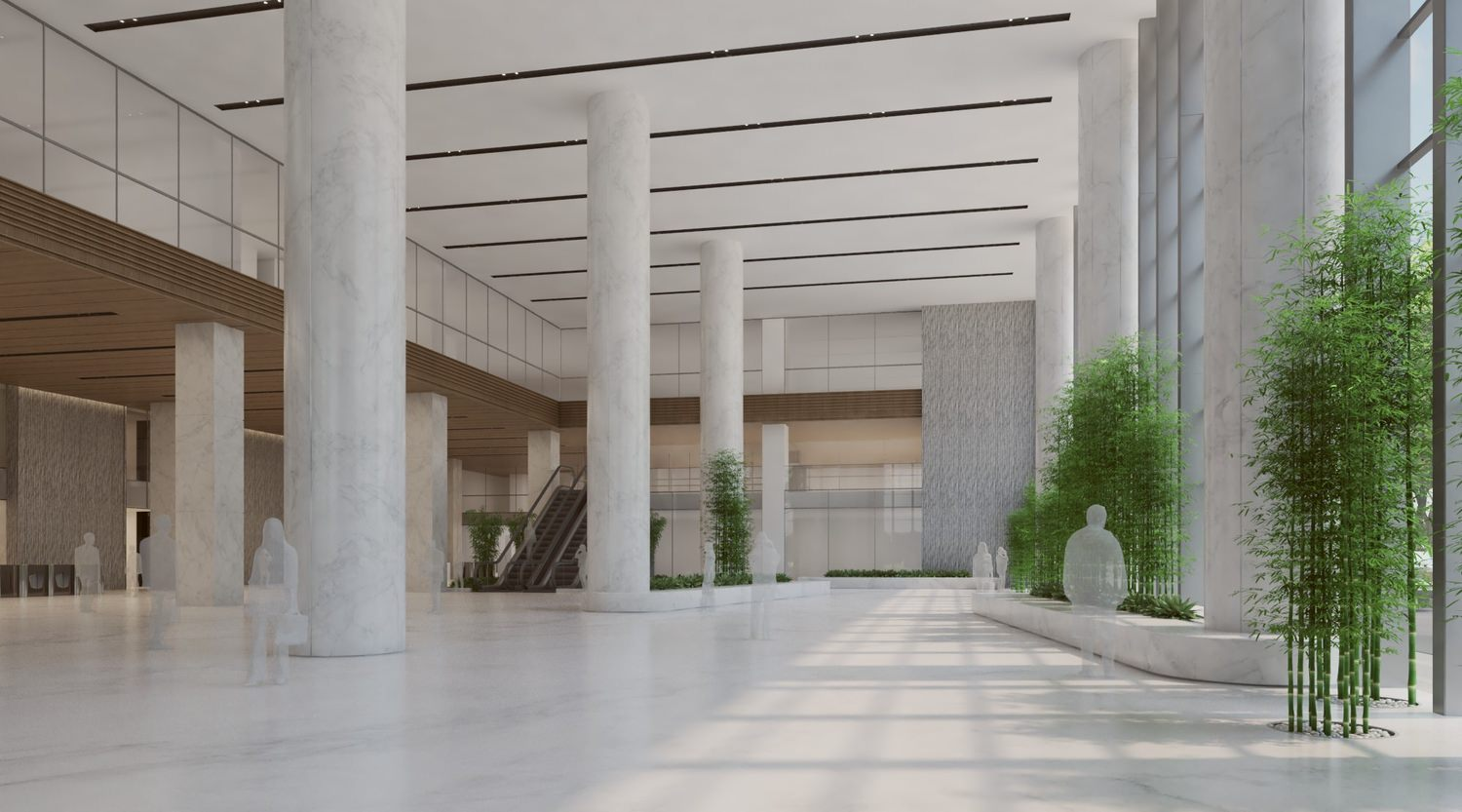 Large lobby with marbled columns and tiled floors that is within a big building.