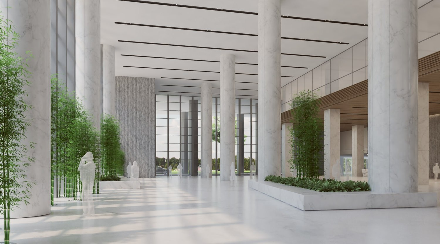 Large lobby that is made of white columns and tiles with plants along the windows.