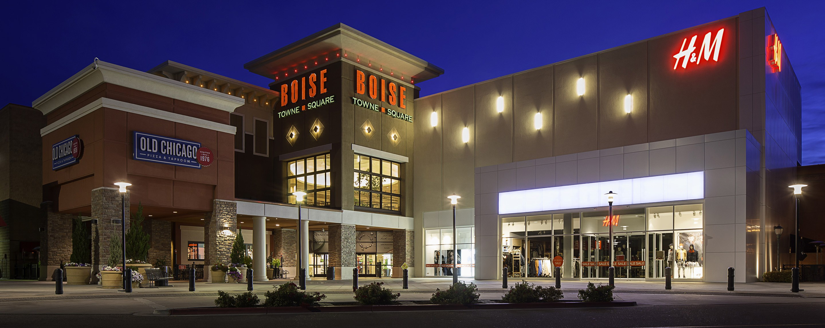 Boise Town Square shopping center featuring  Old Chicago is seen lit up at night.