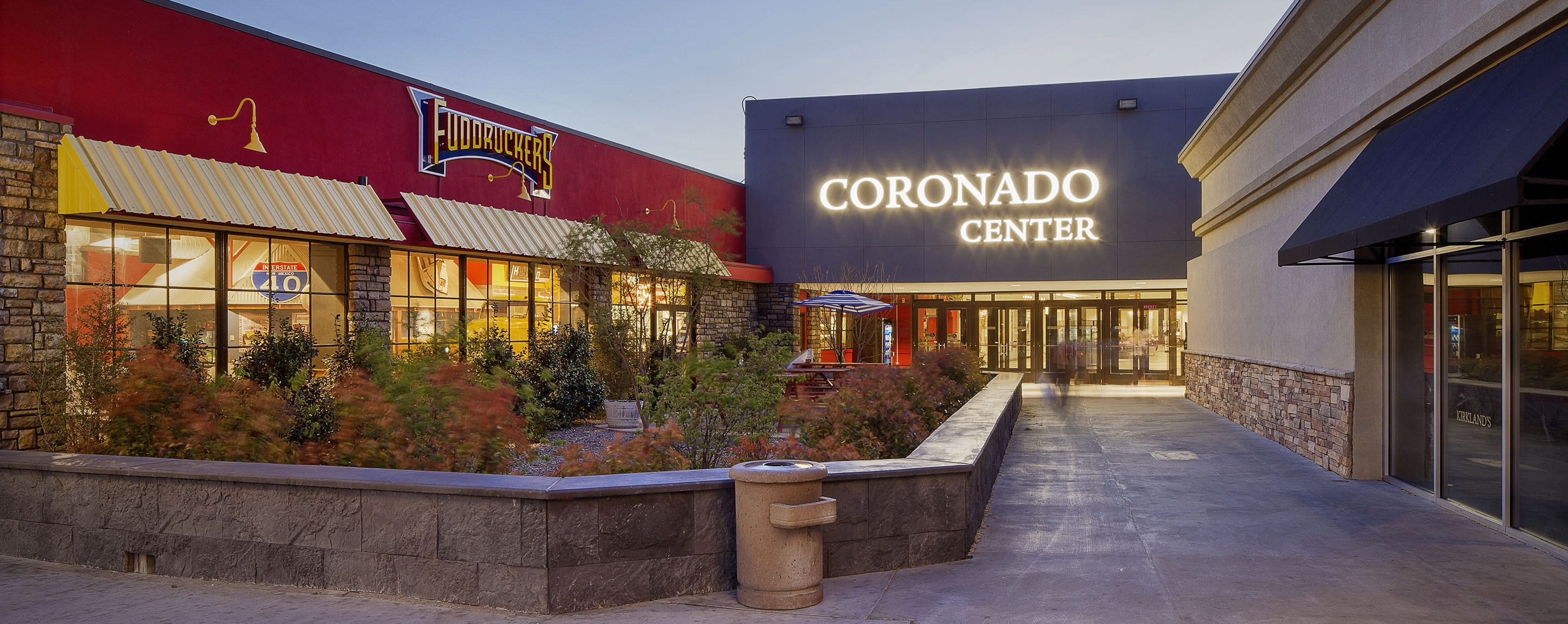 A sign for Coronado Center lights up a courtyard. A Kirland's store is visible.