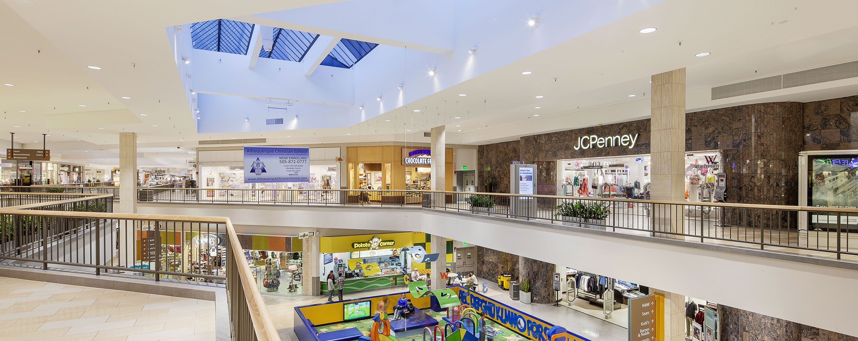 Walkways pass by stores such as JCPenney, Sears, Claire's, Potato Corner and Kohl's in an indoor mall.