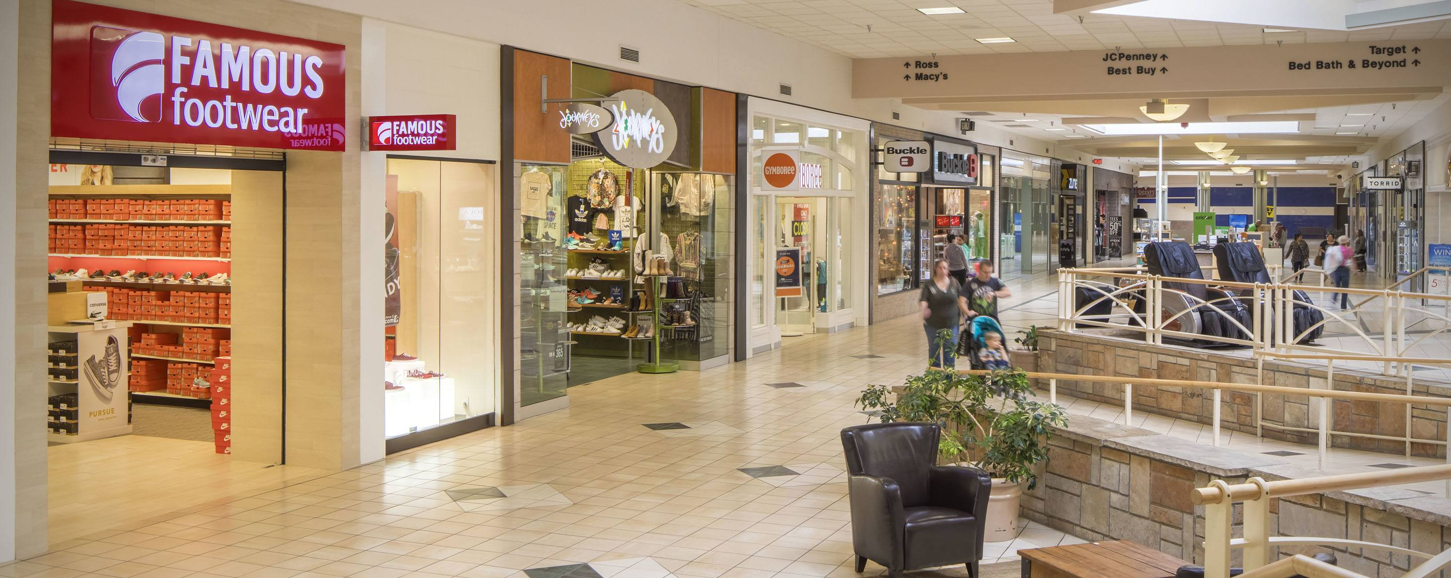 An indoor shot of a line of mall storefronts, including Famous Footwear and Journeys