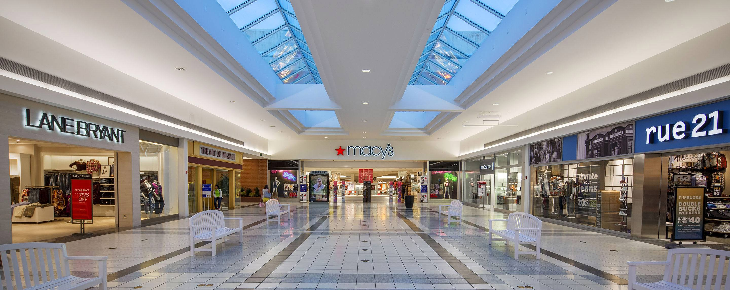 A shot down a mall hallway, with views of Macy's Lane Bryant, Gift, and Lenscrafters.
