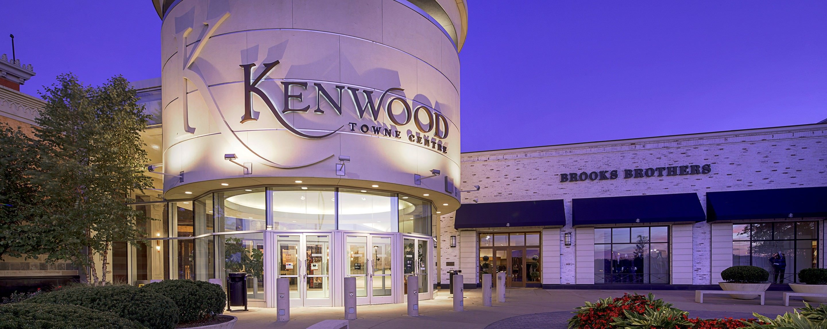 A Brooks Brothers store stands behind a tower for the Kentwood Town Centre.