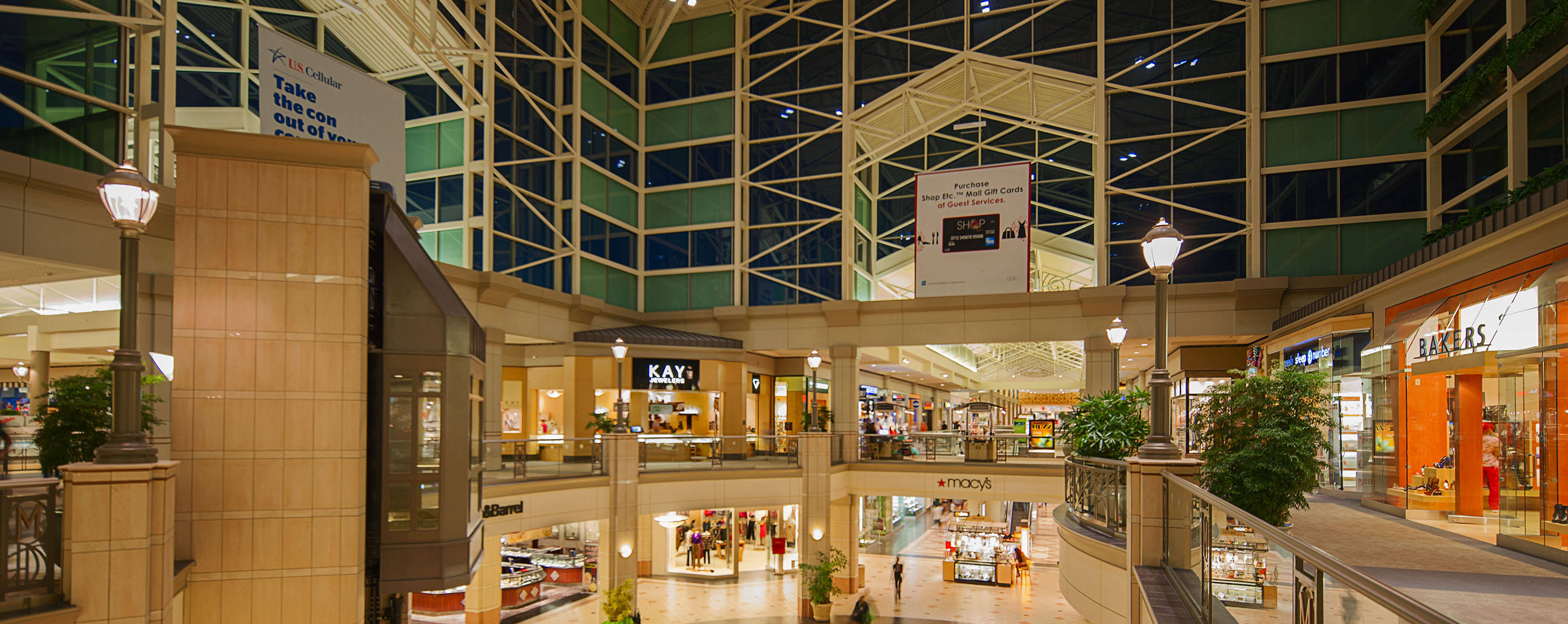 A large open area of a two-story mall with high ceilings and open windows. Kay Jewelers overlooks the bottom floor.