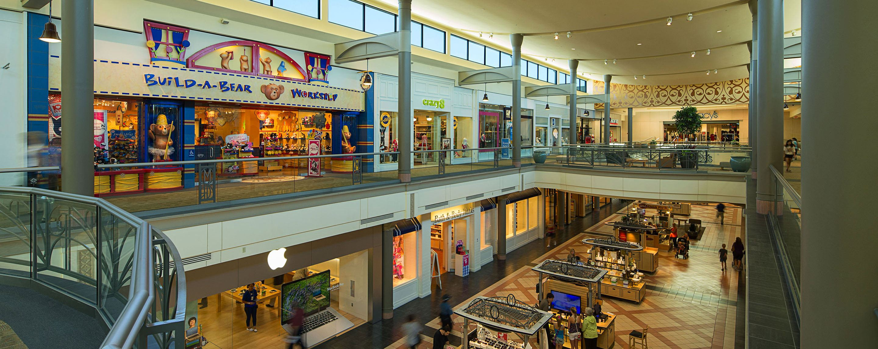 A Build a Bear store standing on the second floor in a shopping mall looks over the court below.