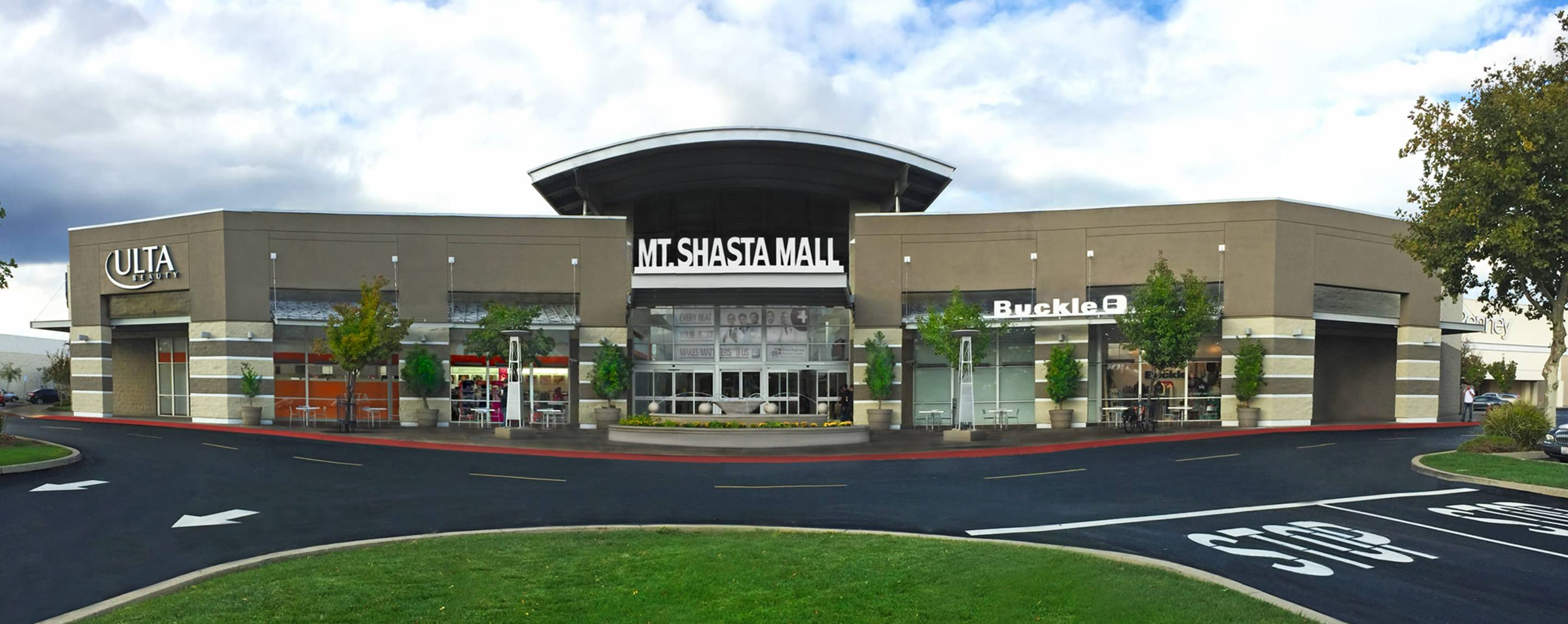 A freshly paved road leads up to the Shasta Mall. An Ulta storefront stands on the left.