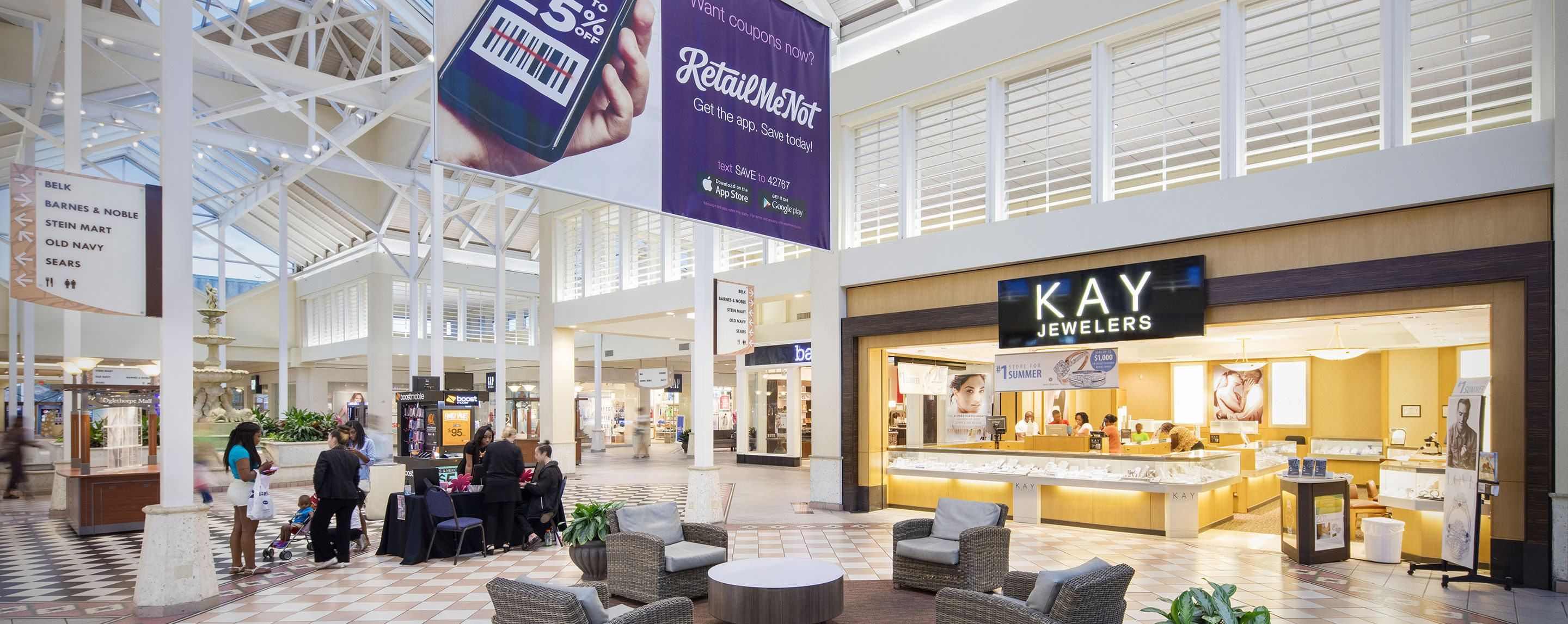A mall with several people and a Kay Jewelers shown.