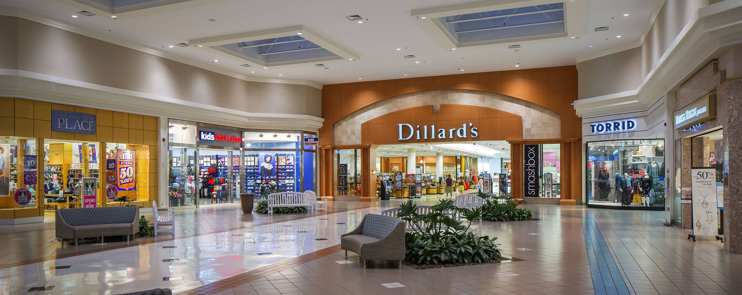 A large indoor mall with a TORRID, Dillard's, and kids foot Locker.