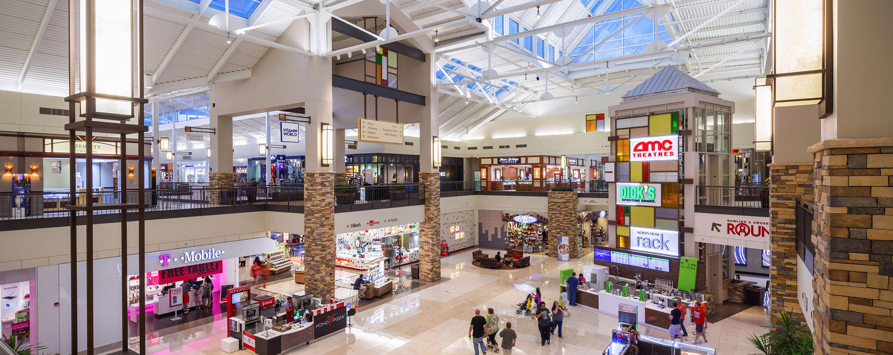 T-Mobile, AMC Theaters, Dick's, Round One, and Nordstrom Rack are some of the businesses located at this semi-crowded mall.