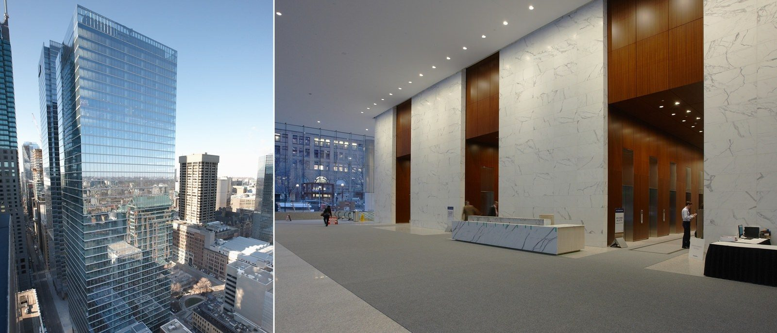 A large glass building in a city that has a very big lobby that has a desk and elevators in it.