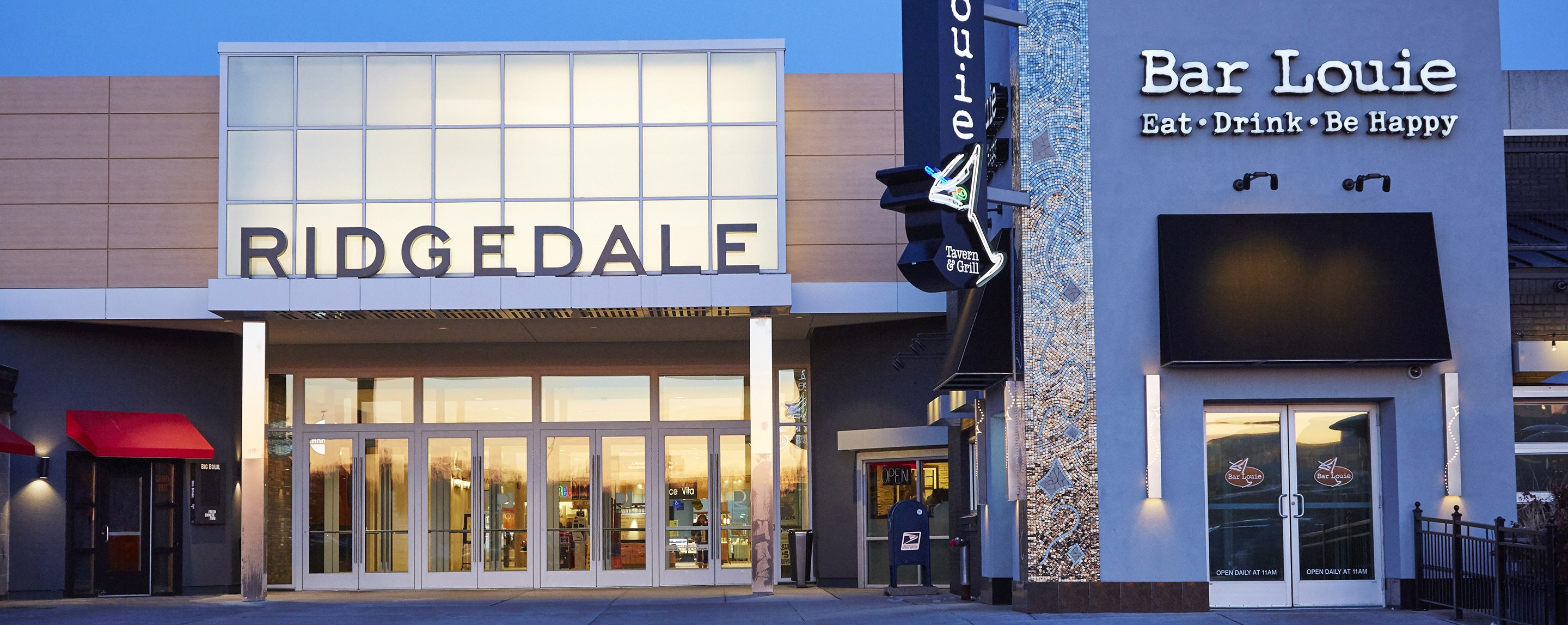A Ridgedale store and a Bar Louie restaurant neighbor each other in a commercial neighborhood.