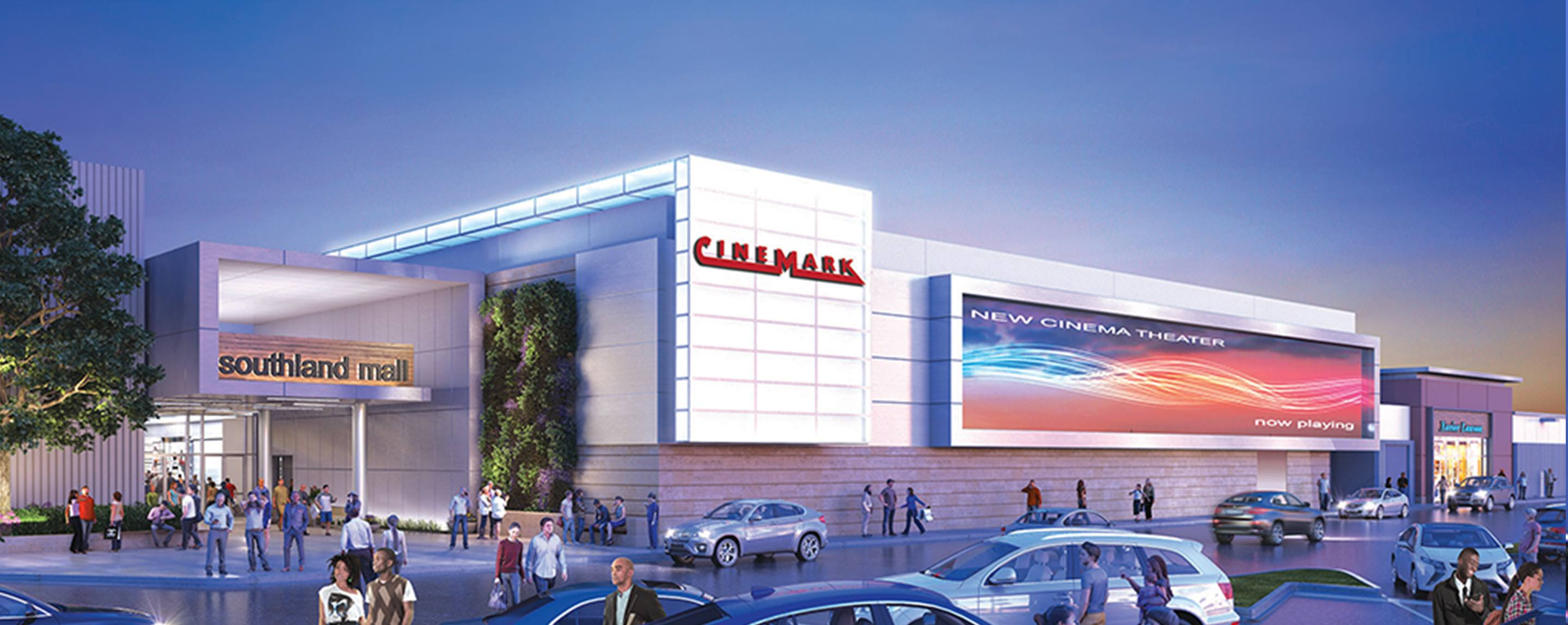 The exterior of the Southland Mall is bustling with people and cars.  There is a Cinemark in the bui