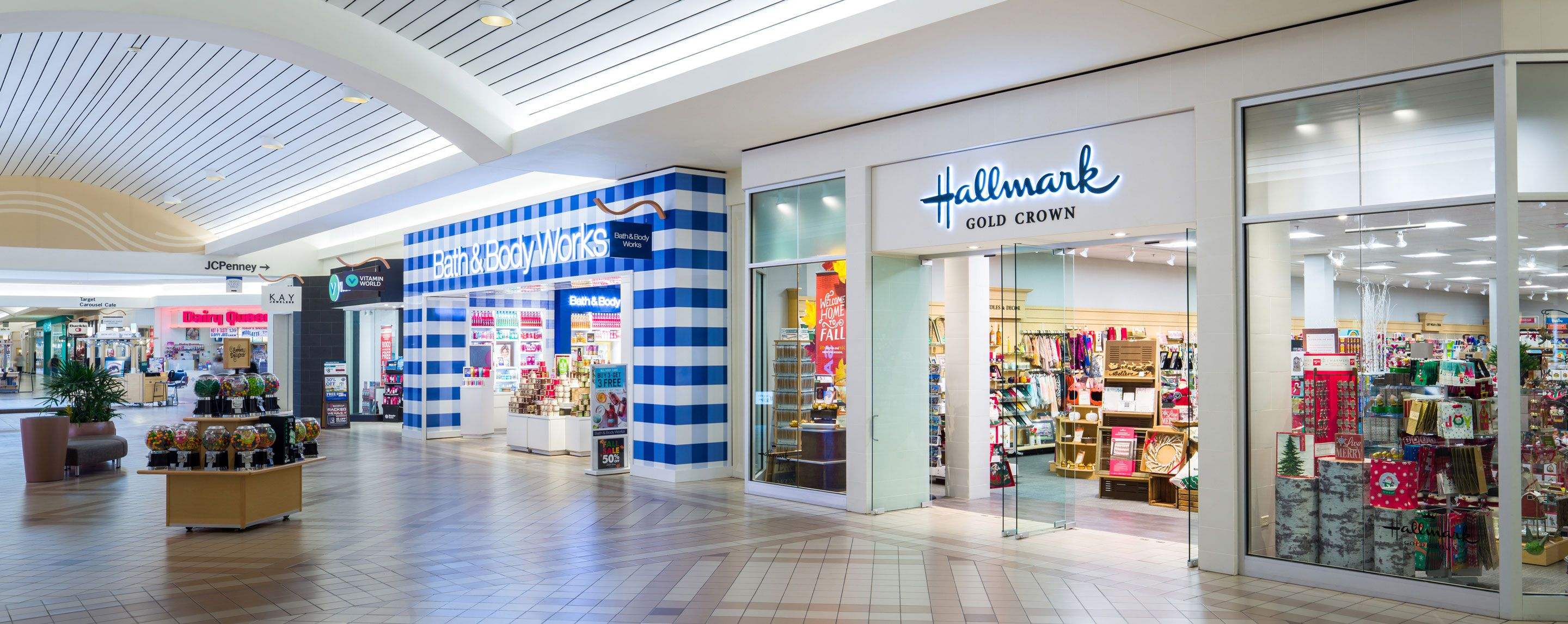 An interior shot of a line of mall storefronts. A Hallmark Store and Bath and Bodyworks are visible.