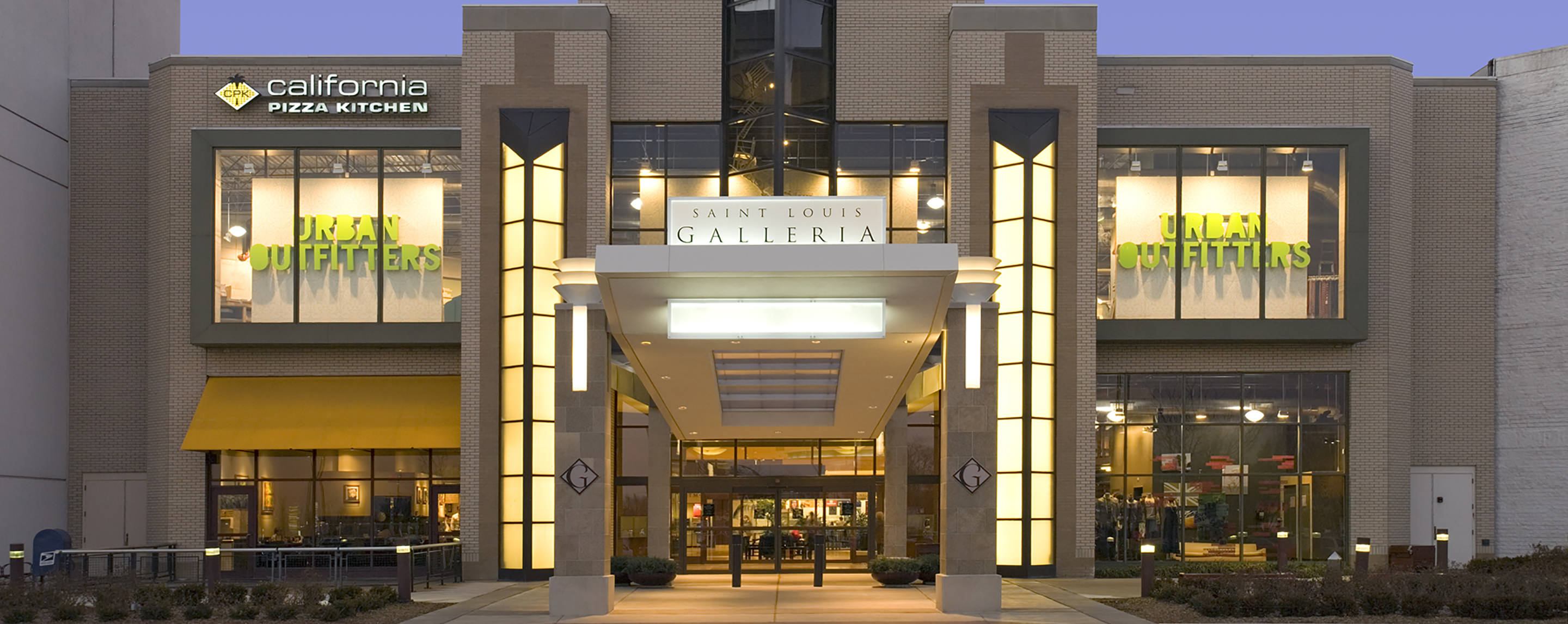 An exterior shot of the Saint Louis Galleria. An Outfitters storefront is visible.