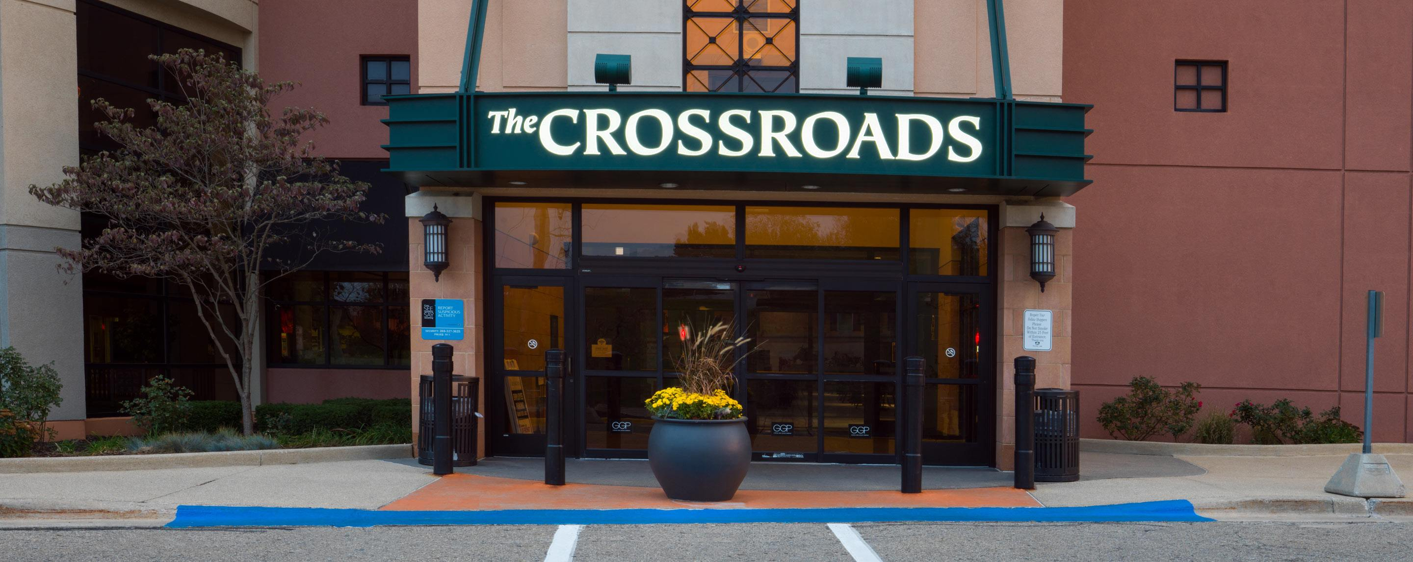 The entryway of an establishment called The Crossroads. The doorway opens onto a sidewalk.