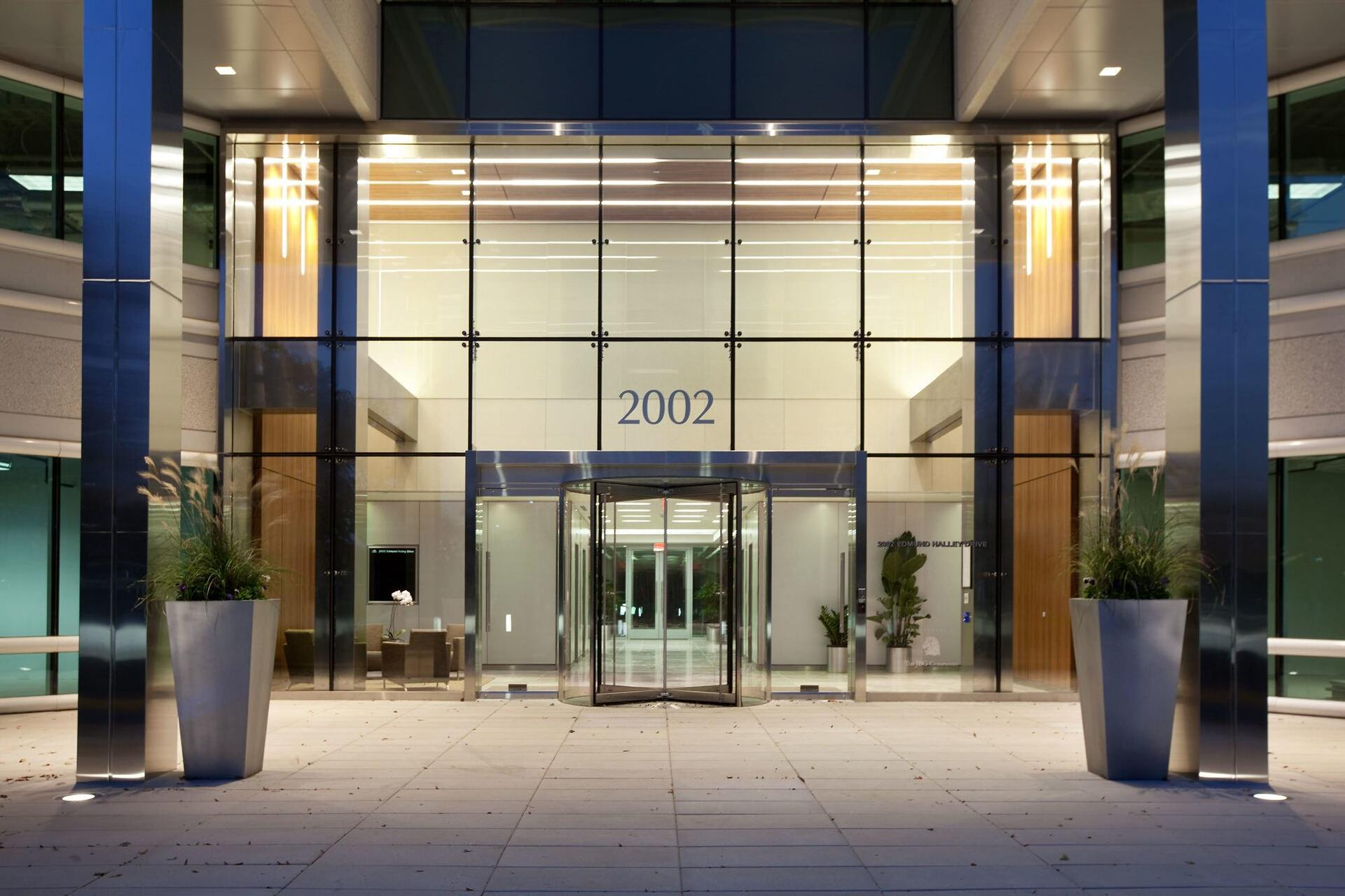 A Large Building Constructed on the year 2002  with a large glass window and revolving glass door seen