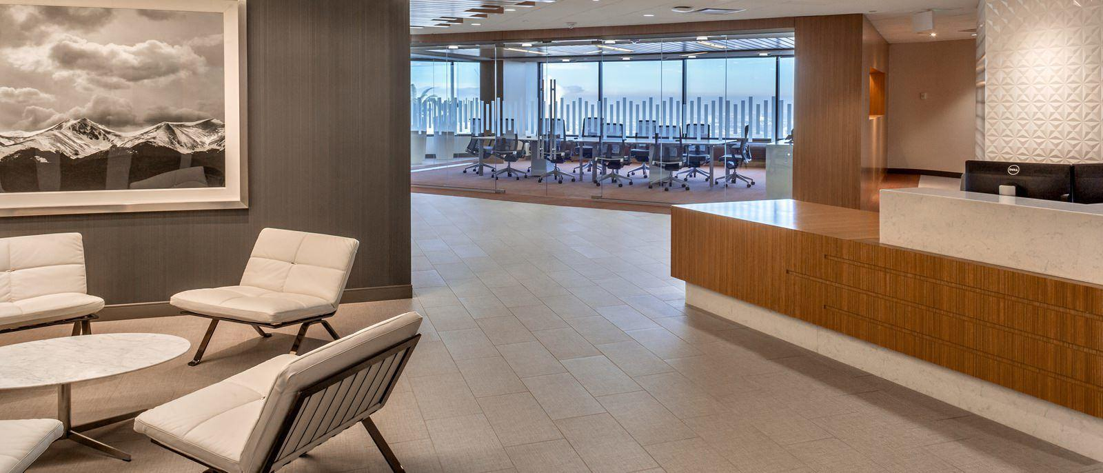 View of a lobby with a glass conference room behind it.