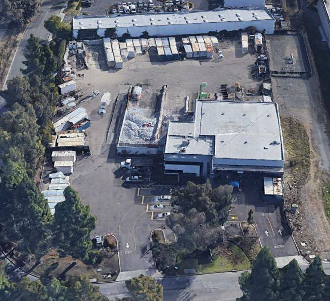 Aerial view of 40595 Albrae Street, a large warehouse with a lot of parking.
