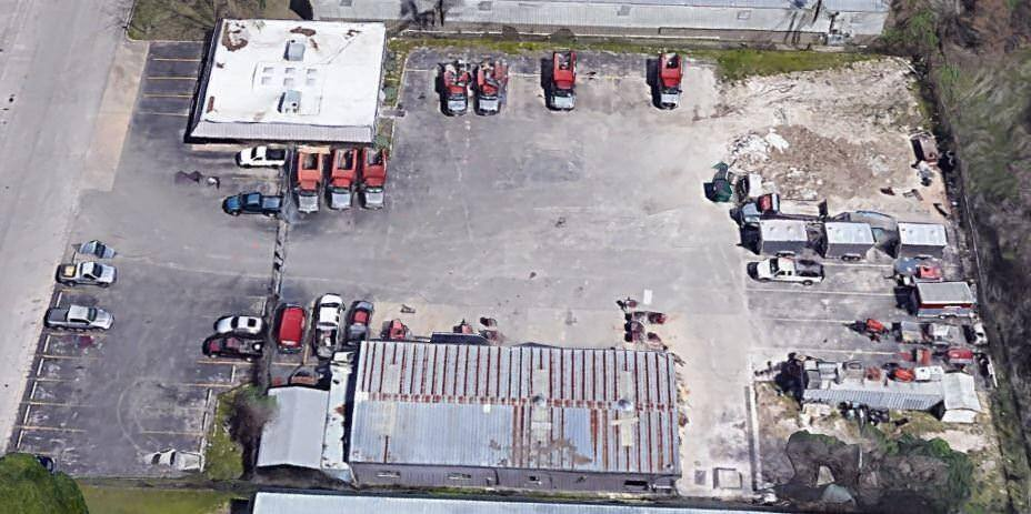 Aerial view of 4201 Felter Lane, a warehouse with a lot of parking for large trucks.