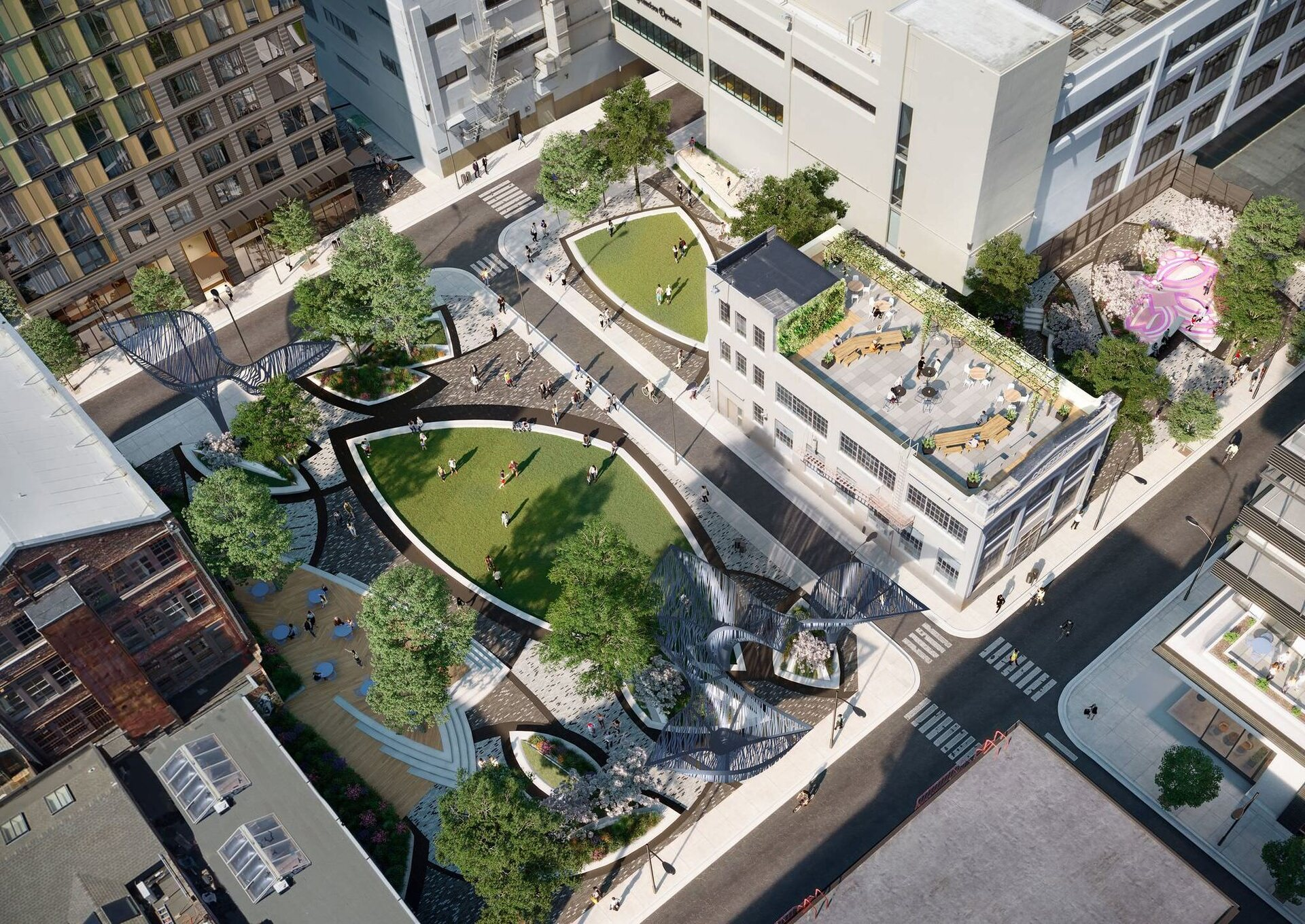 Aerial view of the property showing a rooftop seating area and a sculptural park.