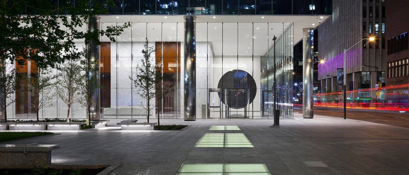 Exterior view of the lobby from the street, which is visible through large, glass windows.