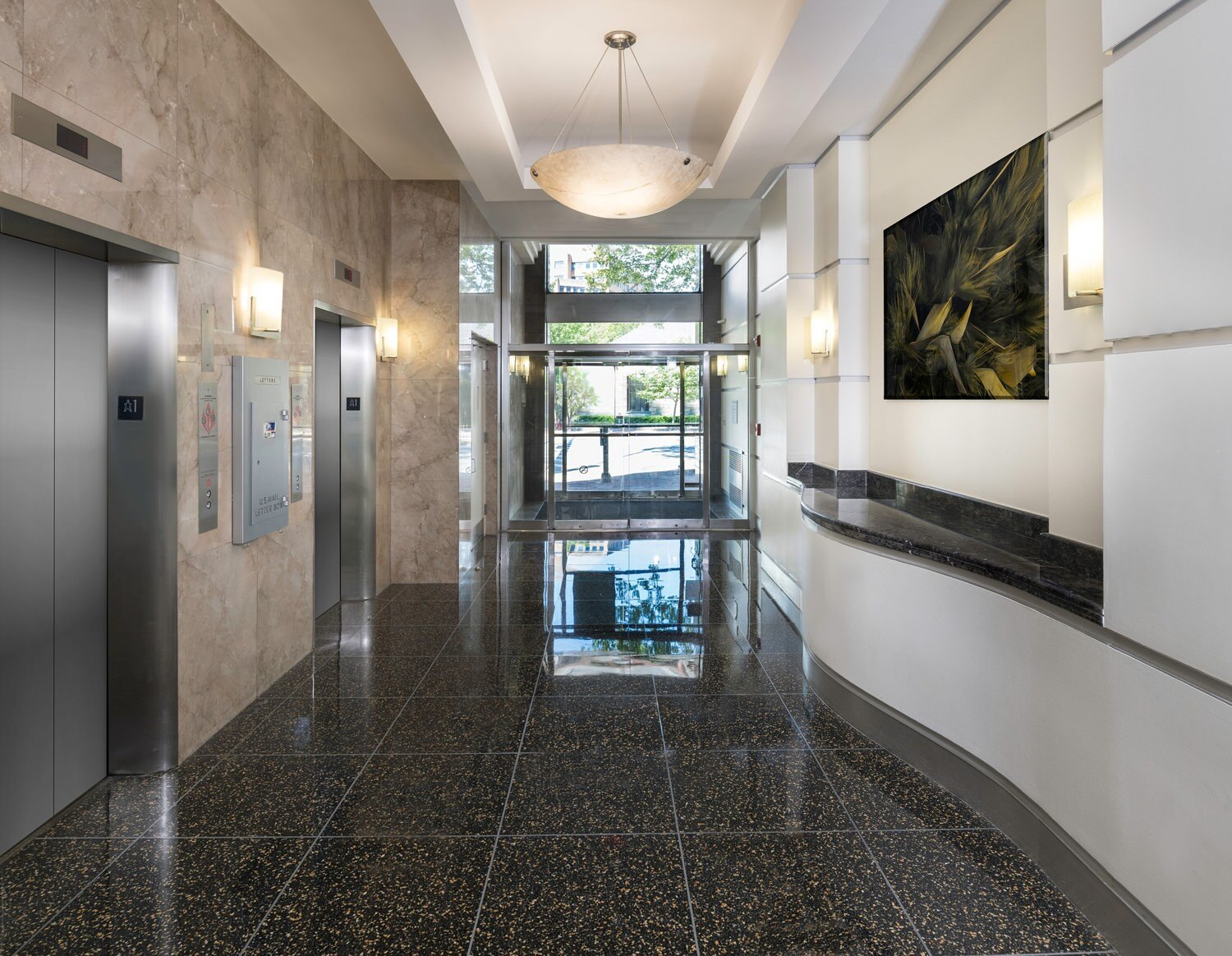 A tiled entryway with elevators.