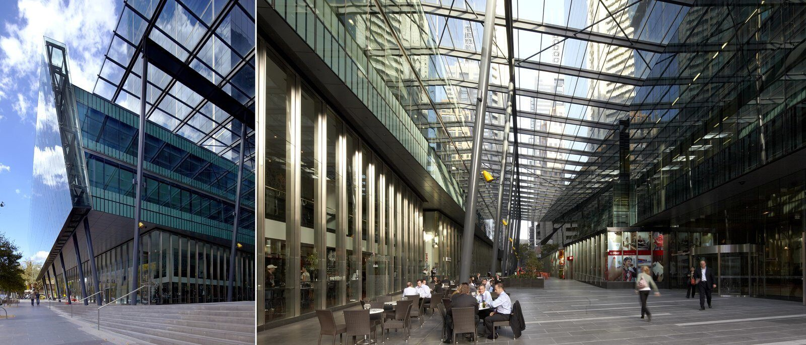 A large area between buildings has many business people in suits doing work on laptops.