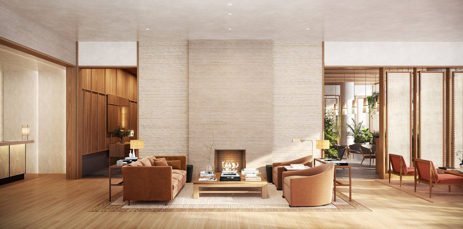 A living room in a house that has a fireplace in the wall and there are couches and chairs in it as well.
