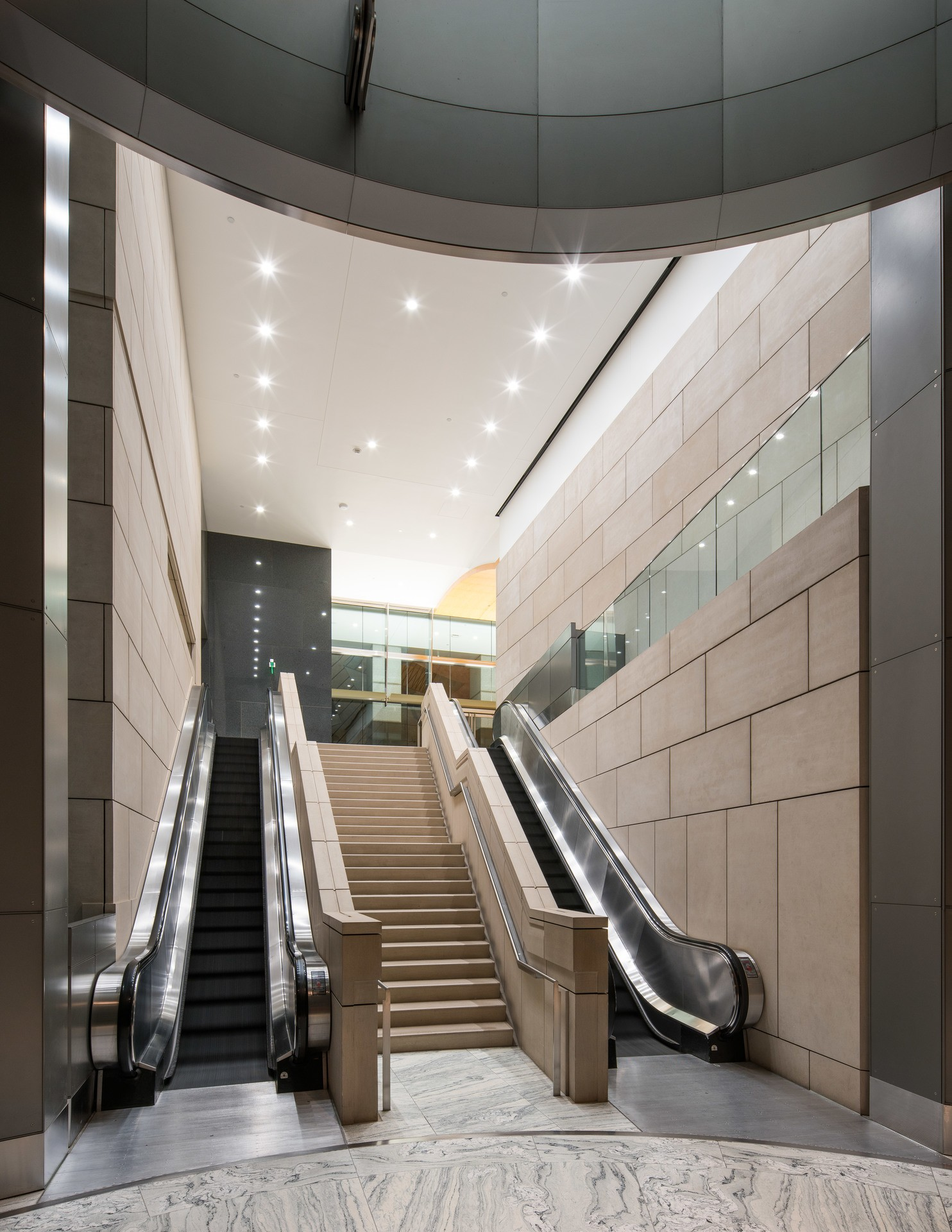 An escalator that connects two floors of the building.
